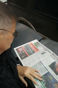 sf-examiner-newspaper-reading-taxi-column