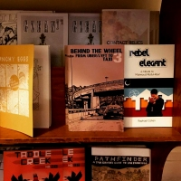 zine-rack-city-lights-taxi-behind-wheel